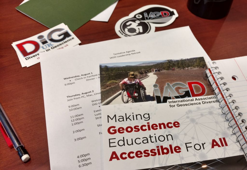 IAGD brochures, stickers, and an agenda from a 2019 leadership retreat.