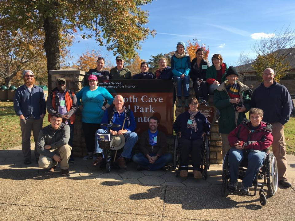 The field trip group poses with the sign in front of the vistior's center at Mammoth Cave National Park.