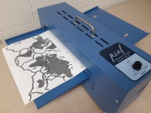 """Harpo """"Pictures in a Flash"""" (PIAF) printer with a textured world map of the tectonic plate boundaries"""